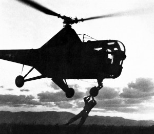 H-5 Dragonfly helicopter during rescue hoist operation.